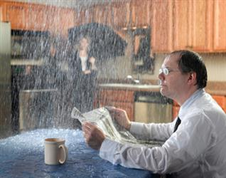 People in need of roof repair in Dracut MA. Leaky roof causing it to rain on people in their kitchen. Humorous.